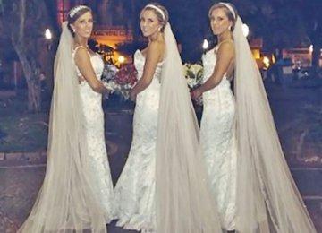 3 כלות מצטלמות כשהן לבושות באותה השמלה. עכשיו, שימו לב לפניה של האישה במרכז…