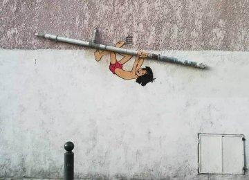 אמן הגרפיטי במחווה לדמויות הילדות של שנות ה90'